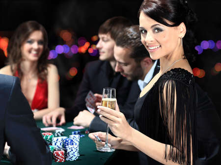 night table: Poker players sitting around a table at a casino Stock Photo