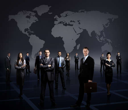 young executives: business team formed of young businessmen standing over a dark background Stock Photo