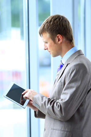Businessman using his tablet in the office photo