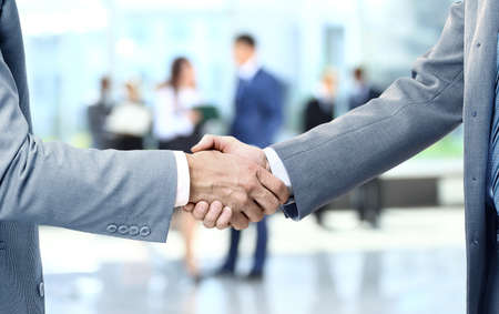 businessmen shaking hands: Close up of businessmen shaking hands Stock Photo