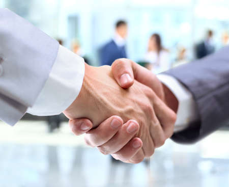 a person: Business handshake and business people Stock Photo