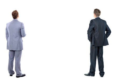hands behind back: two business mans from the back - looking at something over a white background