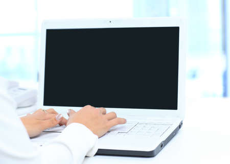 office use: Person Typing on a modern laptop in an office Stock Photo