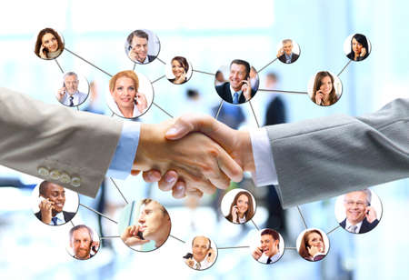 trust people: business people handshake with company team in background Stock Photo