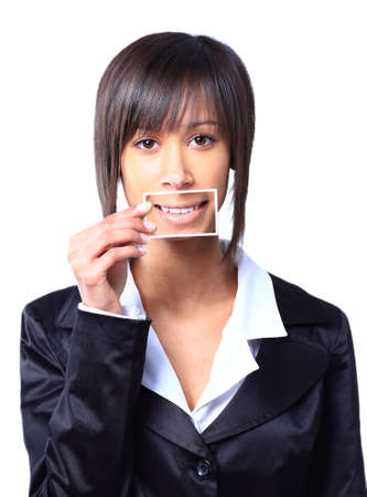 Girl holding a card with photo her smile in front of her mouth photo