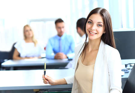company employee: Business woman with her team at the office Stock Photo
