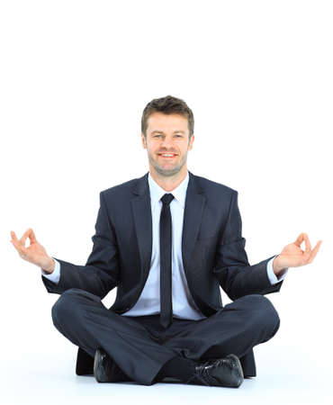 businessman meditating in yoga lotus pose on floor photo