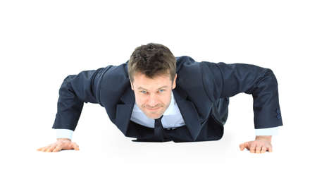 handsome service business man doing push ups isolated on white background  photo