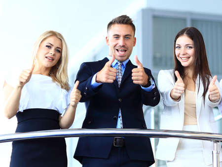 Business team with the thumbs up in a stairs photo