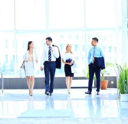 businesspeople walking in the corrido photo