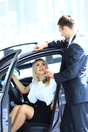 Woman buying a new car photo