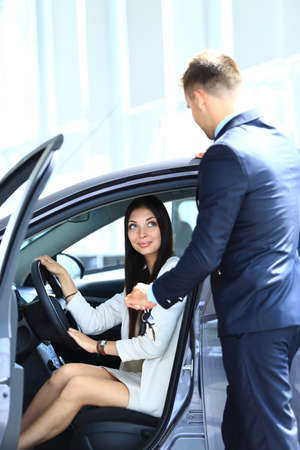 Woman buying a new car Stock Photo - 22142248