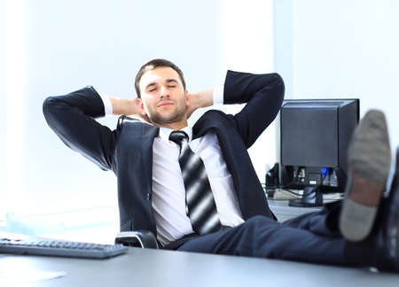feet on desk: Satisfied businessman relaxing in his office