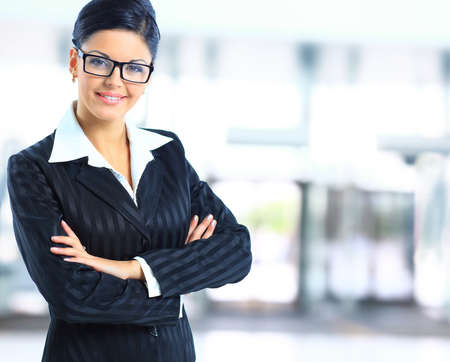 company building: A portrait of a young business woman in an office  Stock Photo