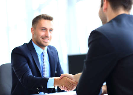 hands joined:  businessman shaking hands to seal a deal with his partner