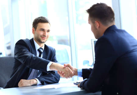 joined hands:  businessman shaking hands to seal a deal with his partner