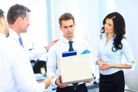 termination: dismissed businessman carrying box Stock Photo