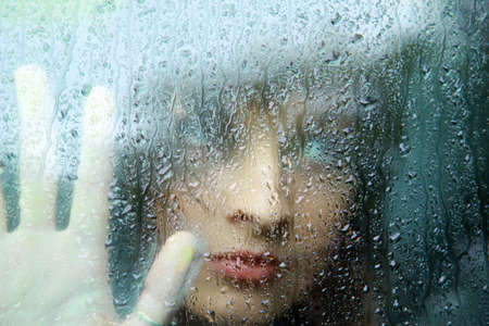 Sad young woman and a rain drops  photo