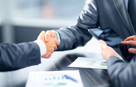 handshaking: Business people shaking hands in office Stock Photo
