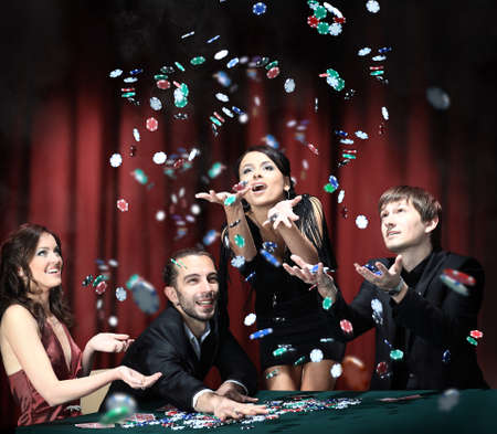 playing with money: Young people have a good time in casino