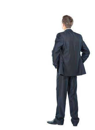 espalda: hombre de negocios de la parte posteriora - mirar algo sobre un fondo blanco