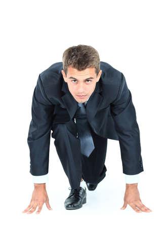 empezar: iniciar su negocio - hombre de negocios listo para empezar a correr m?s de blanco