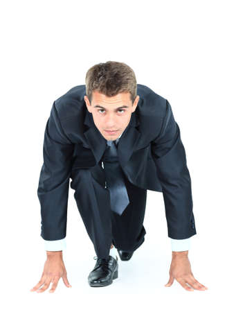 willingness: start your business - business man ready to start running over white Stock Photo