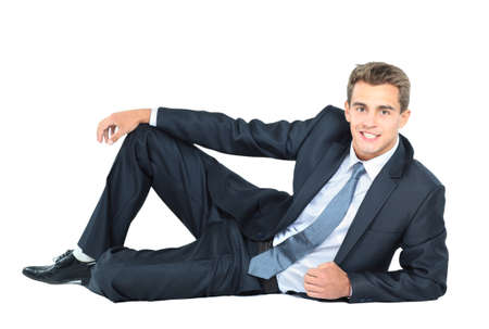mid adult men: Portrait of business man sitting on the floor isolated over white background
