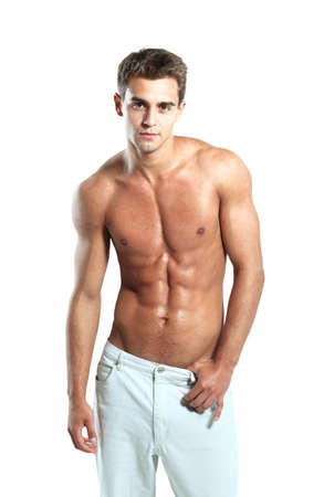 a young male model posing his muscles Stock fotó