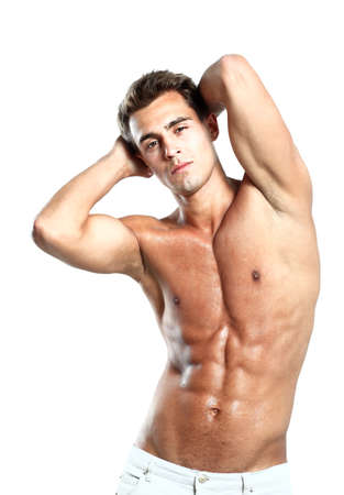 naked belly: a young male model posing his muscles