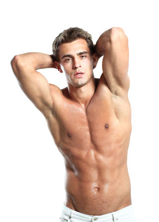 a young male model posing his muscles photo