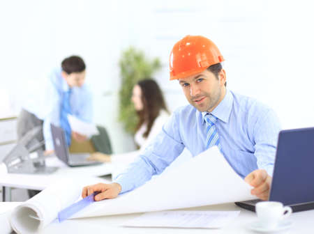 construction manager: Portrait of an architect in the office