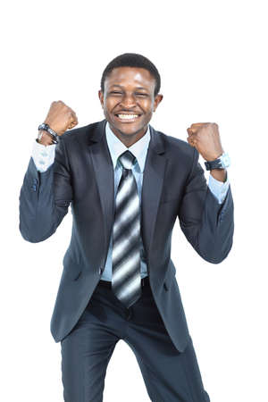Portrait of an excited businessman with arms raised in success on white background photo