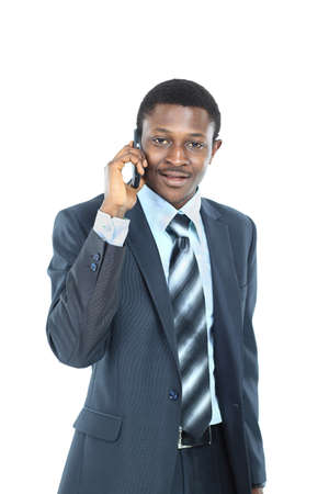 Young entrepreneur holding his coat over shoulder while talking on cell phone photo