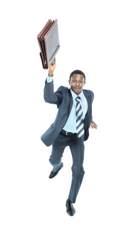 Businessman running with a briefcase, isolated on white background photo