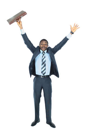 Full length of an excited handsome business man with arms raised in success - Isolated on white photo