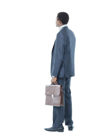 African American business man from the back looking at something isolated white background photo