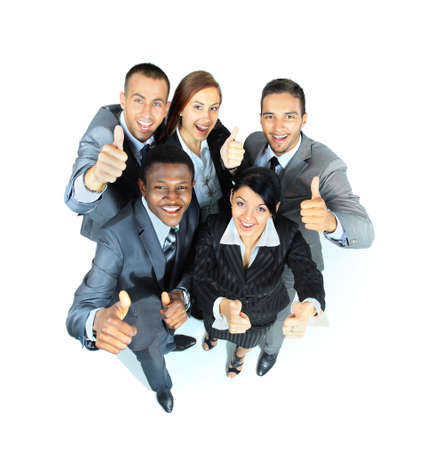 Young group of business people showing thumbs up signs in joy photo