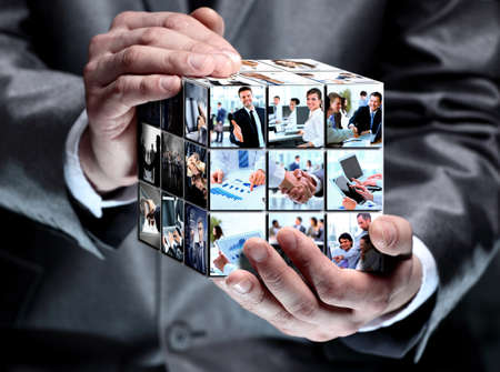 transformation: man holding abstract cube with business images