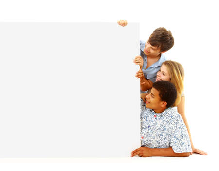 Portrait of happy men and women standing with a billboard against white background Stock Photo - 22519099
