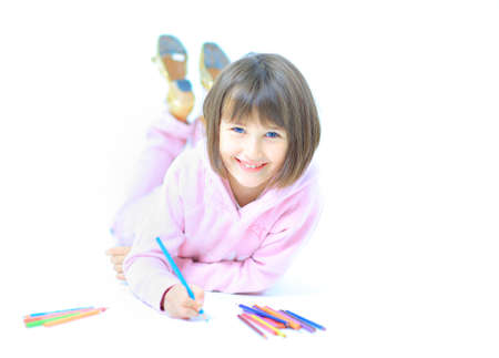 The beautiful girl drawing pencils in a sketch pad on the isolated white background Stock Photo - 22276824
