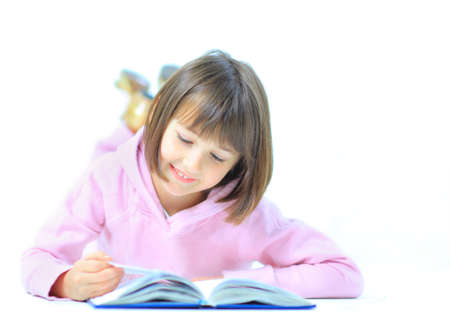 lieing: Little girl lieing on the floor and reading book