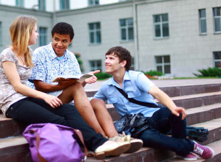 Group students outside sitting on steps  photo