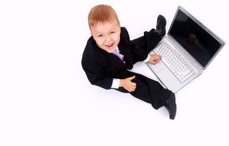 Little child and laptop Isolated on white background Stock Photo - 22276834