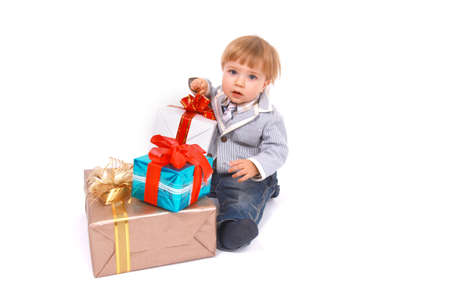 Baby boy sitting with Christmas present photo