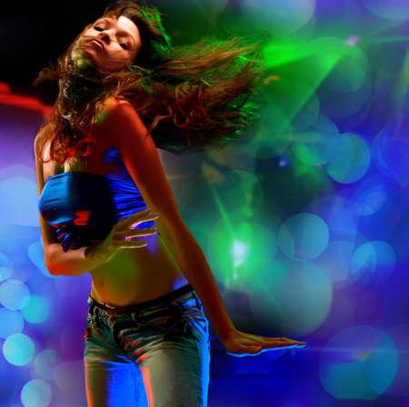 disco girls: Beautiful young woman dancing in the nightclub