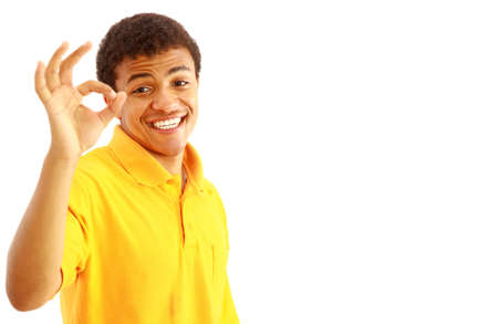 Young guy showing the okay sign over white background  photo