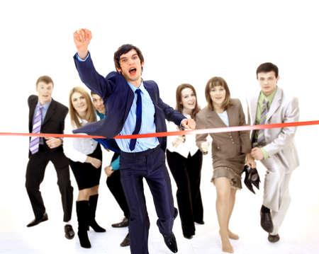 フィニッシュ ラインを横切るビジネスマン 写真素材
