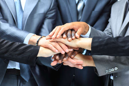 Handshake business: Closeup portrait of group of business people with hands together Stock Photo