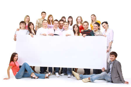 young add: Portrait of happy men and women standing with a billboard against white background